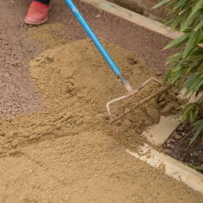 filling lawn area with sand