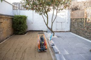 fine-leveled lawn area and laid patio in clapham sw4