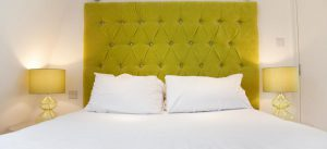 green tufted upholstered headboard