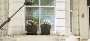 Cleaning uPVC Windows Sills with warm soapy water