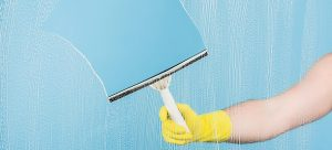 cleaning window with squeegee