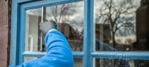 Cleaning a Window with a squeegee