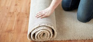 person rolling a new carpet