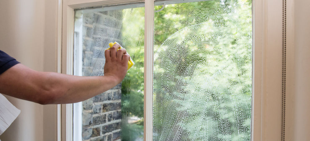 window cleaning with sponge