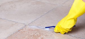 Cleaning tile grout with a toothbrush