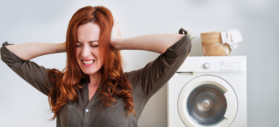 noisy washing machine when spinning and frustrated woman