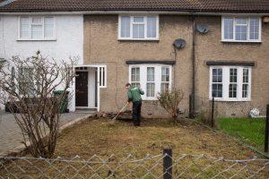 fantastic gardener raking lawn