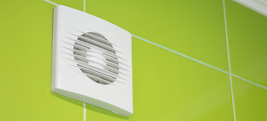cleaning a bathroom extractor fan