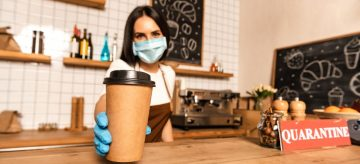 woman giving coffee