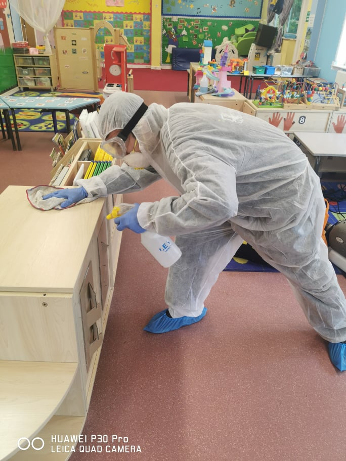 fantastic technician disinfecting class room