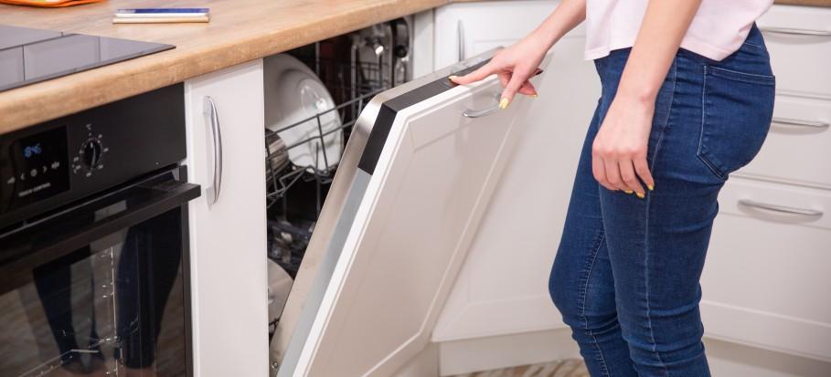 woman opening up dishwasher
