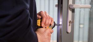 Local locksmith is replacing a UPVC broken door lock mechanism