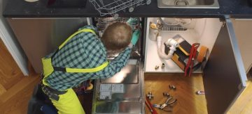 technician installing a dishwasher