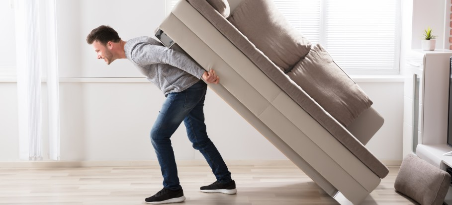 man moving sofa