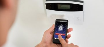 A man using a smart home security system
