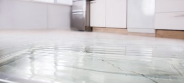 fridge leaking water on the floor