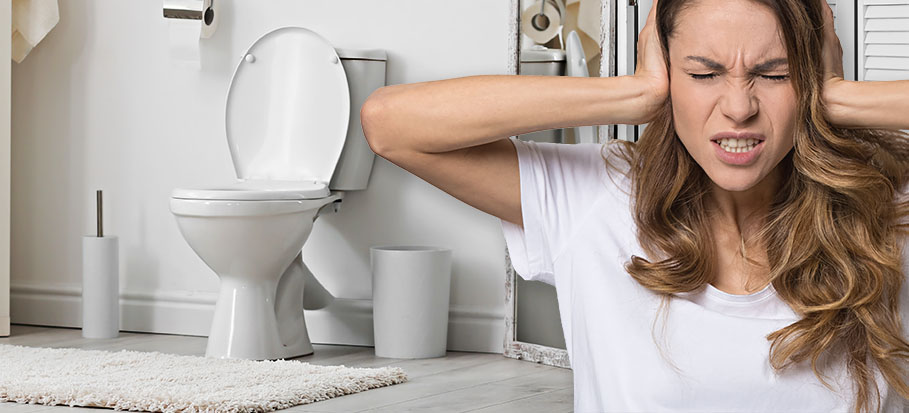 woman covering her ears because of noisy toilet