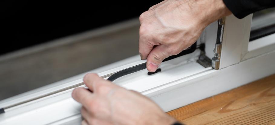 hands replacing rubber seal
