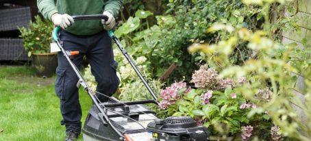 gardeners mowing lawn