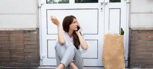 woman stuck outside home