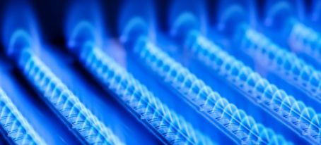 blue flames from gas burner inside boiler