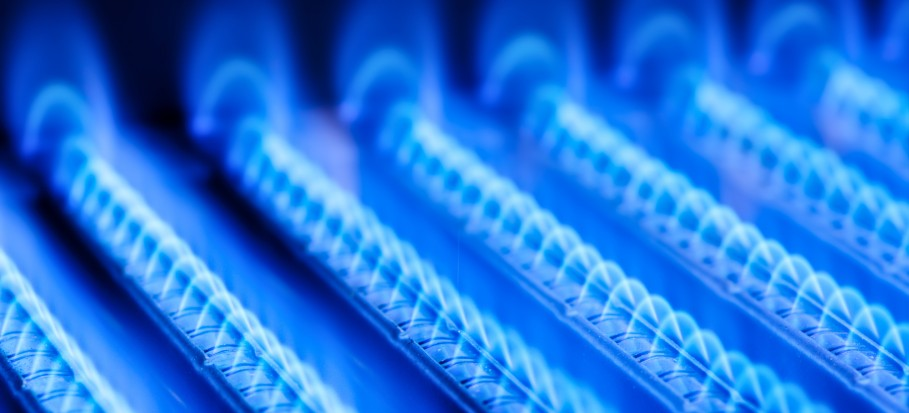 Blue flames of a gas burner inside your boiler.