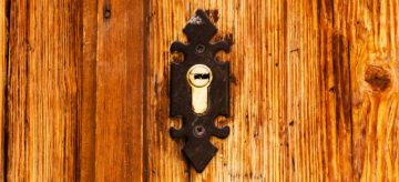 old cylinder lock in wooden door