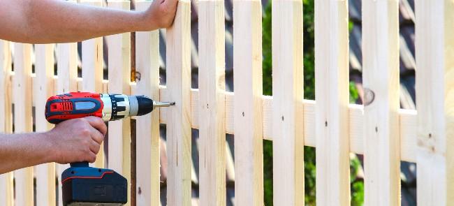 hands building garden fence