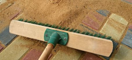 how to stop sand from washing out from paving