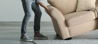 person moving armchair