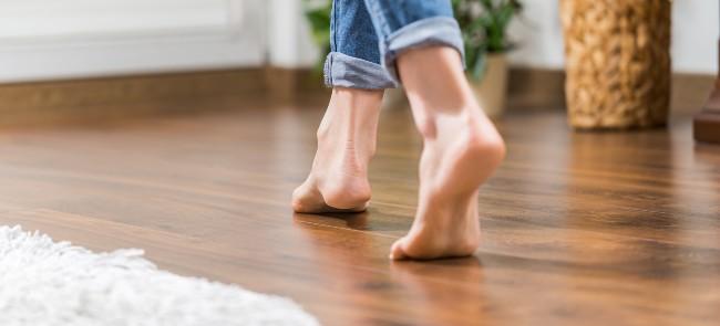 woman walking on wooden floor