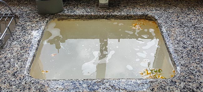 Responsibility for blocked drain - sink blocked with dirty water