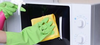 A microwave being cleaned